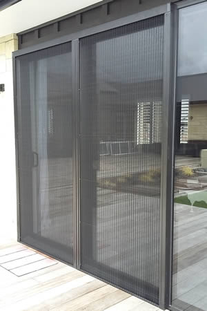 Venette pleated door insect screen mounted with angles